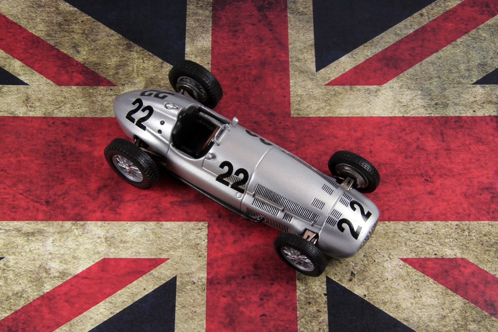 old race car over british flag
